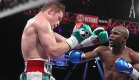 "Round 7 of Floyd Mayweather vs. Canelo Alvarez on ""Showtime Championship Boxing's 30th Anniversary"""