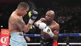 Round 7 of Mayweather vs. Maidana 1 on Showtime Championship Boxing 30th Anniversary